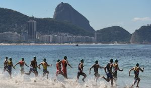 Swimmers enter the water on Copacabana Beach