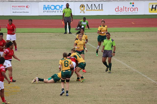 Brooke Anderson tackles hard against Tonga