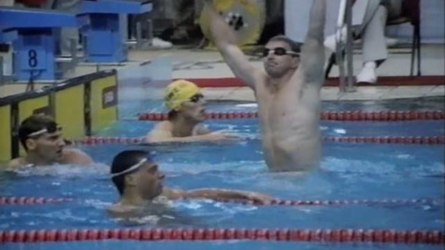 Duncan Armstrong finishes first in 200m freestyle