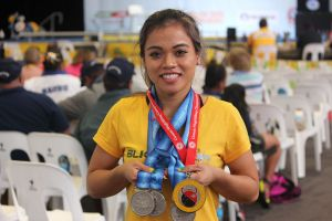 Barter with medals at 2015 Pacific Games.