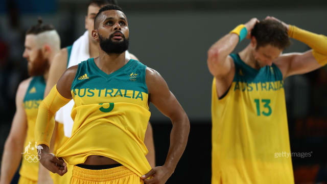 Shattered. Patty Mills puts on a brave face after tough loss to Spain.