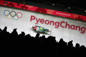Alex Ferlazzo flying down the Olympic luge track on the first day of comp.